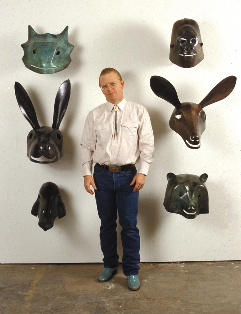 Ken Little with various bronze masks: 1988