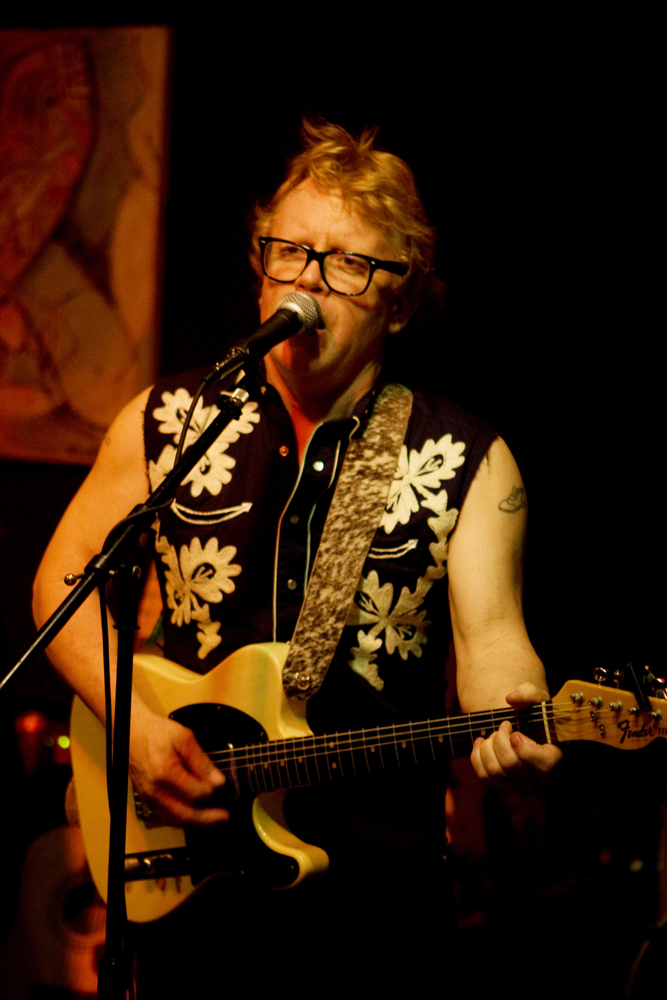 Ken Little at the Hometown Artist's Rodeo 2008; For years I organized a Hometown Artist's Rodeo, first at the UTSA Sculpture building, for a while then, a monthly gig at The Cove, in San Antonio. It has been a sort of cabaret with music, performance art, occasional fire jugglers, crazy dentists, magic acts, and other strange, beautiful, and funny things. It was voted Best Public Art in San Antonio by the San Antonio Current readers in 2007. Look for the Youtube videos. I also play with a couple of bands: Ken Little and Rodeo Ho Ho and the Swingbillies. Look on the home page for upcoming Gigs. I am a songwriter and have one CD of original material titled Simple America available.