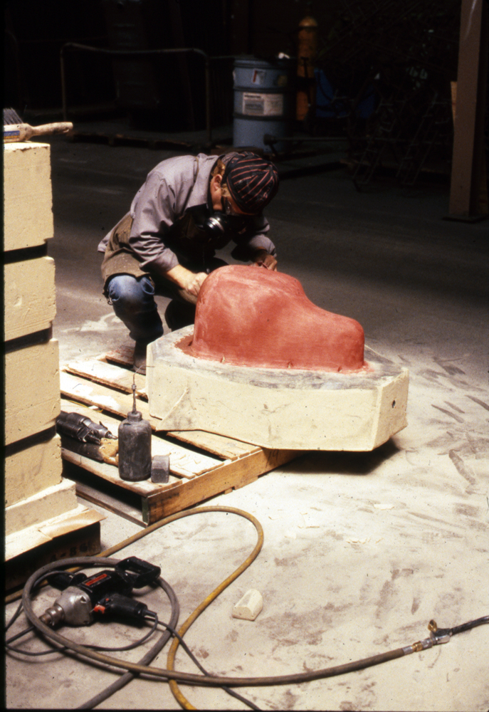 Applying mold conditioner/release to the Hare sand mold, 1988