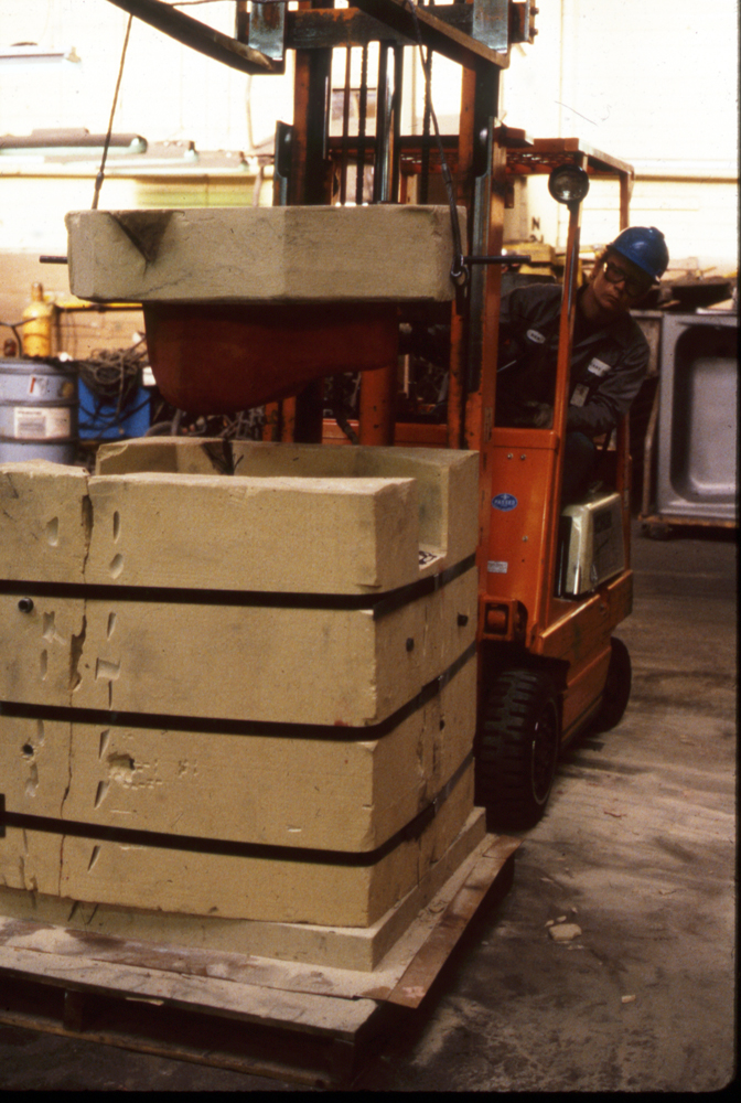 Replacing lid on the Hare sand Mold, 1988