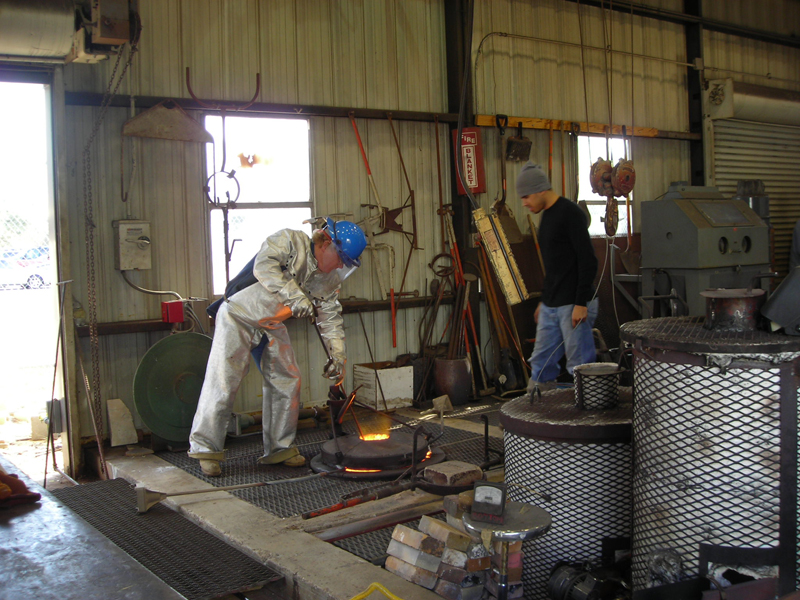Skimming the slag off the top of the molten Bronze