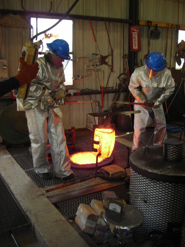 Removing the crucible from the melting furnace