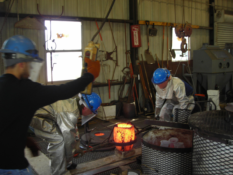 Putting the crucible in the pouring yoke