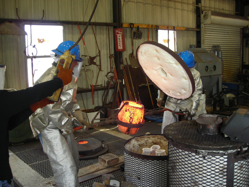 Opening the preheating kiln to expose the ceramic Shells